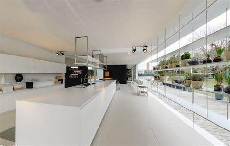Modern white kitchen island with suspended industrial storage running