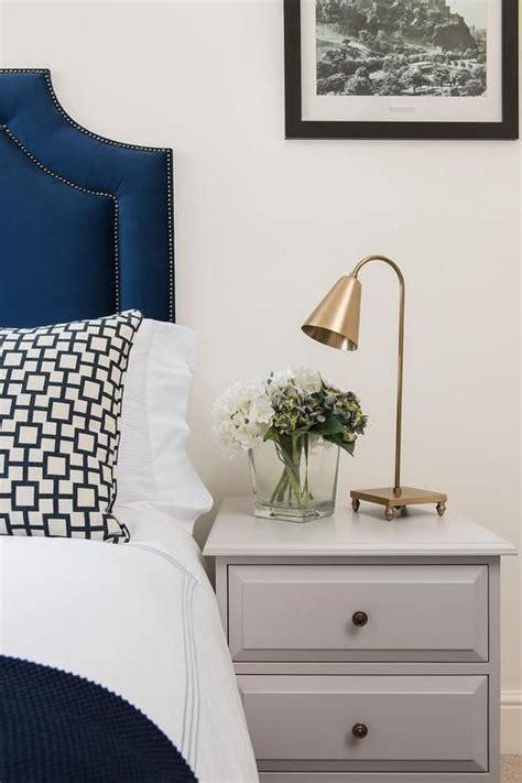 sophisticated bedroom features  blue velvet headboard