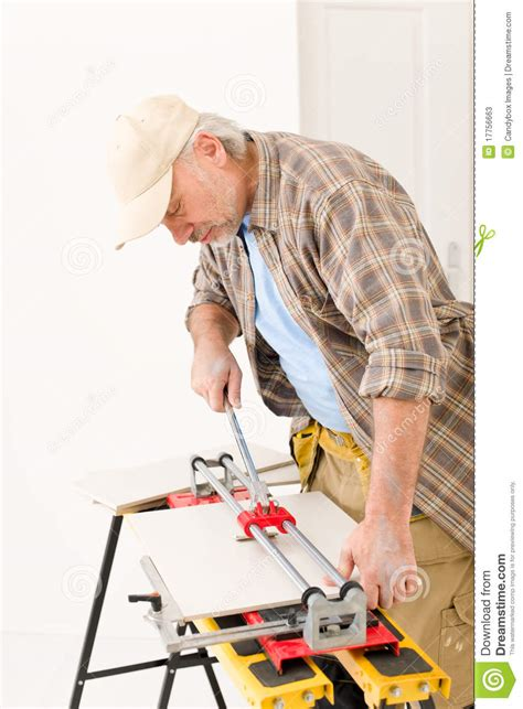 home improvement handyman cut tile stock photos image