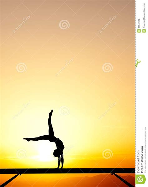 handspring  female gymnast  sunset sky stock