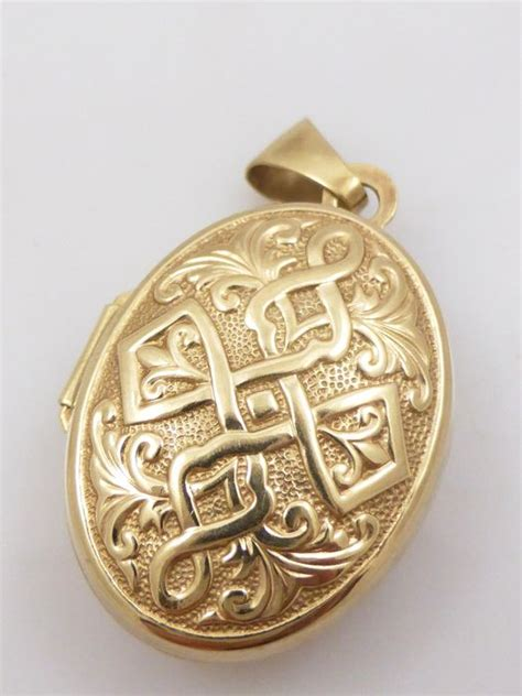 gold pattern locket yellow gold locket with celtic pattern catawiki