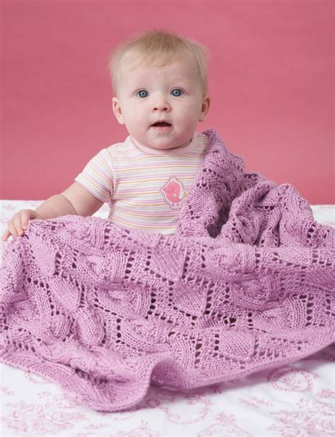 knit baby blanket pattern sport weight yarn yarnspirations bernat cable and lace blanket
