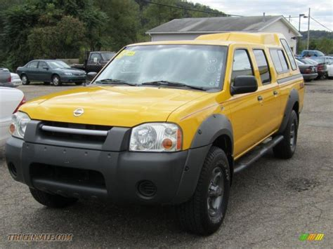 yellow nissan truck 2002 nissan frontier xe crew cab 4x4 in solar yellow photo