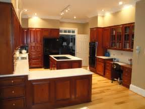 What Color Kitchen Cabinets With Wood Floors by Hickory Floors Cherry Cabinets Black Appliances And