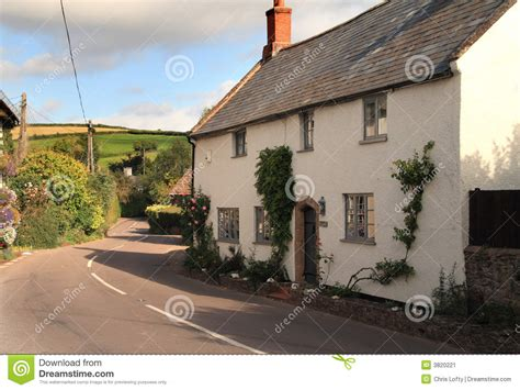 cottage next to a stock image