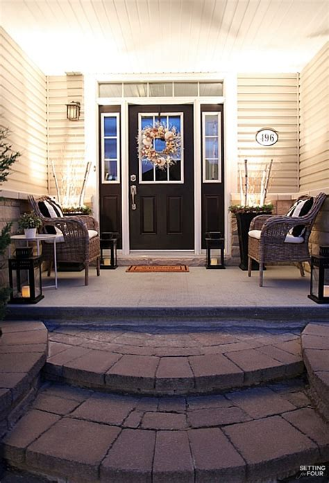 house porch at night curb appeal ideas and porch decor tips setting for four