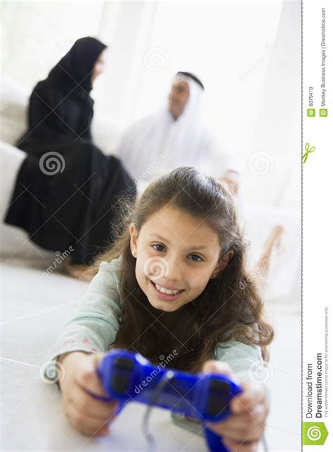 middle eastern girl playing  video game stock photo