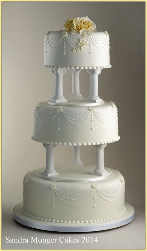 Wedding Cake Pillars by Classic Pillar Wedding Cake With Piped Swags And Flowers