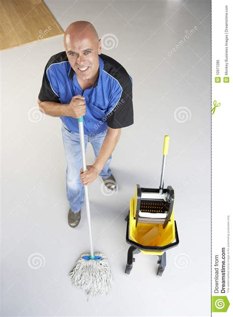cleaner mopping office floor royalty free stock photo