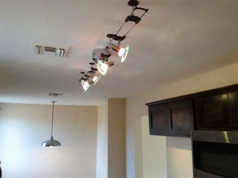 track lighting illuminates a fireplace in a modern living 17 contemporary track lighting ideas to enlighten your house