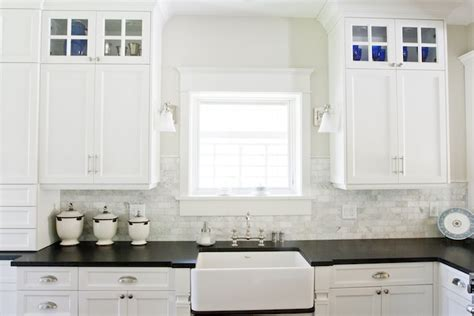 white cabinets with black countertops transitional