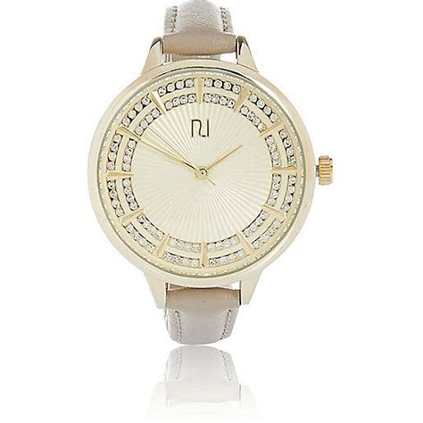 gold tone embellished watches on