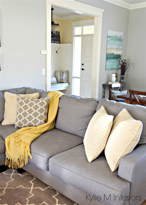 grey and yellow home decor how to make a gray paint colour feel warm shown in living room with revere pewter gray