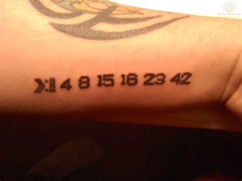 tribal tattoo numbers small digits black ink numbers with tribal on wrist