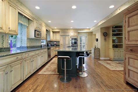 antique white kitchen with wood floors and an island sink pictures of kitchens traditional two tone kitchen