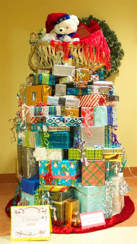 christmas tree made out of christmas presents gift wrapped