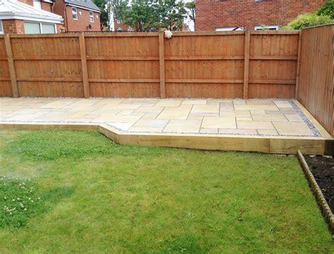 patio area raised railway sleeper patio area with hexagonal shaped path aplg landscape groundwork