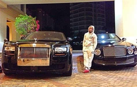 bentley floyd floyd mayweather poses in front of his incredible