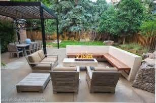 l shaped wood decking seating and armchairs with cushions