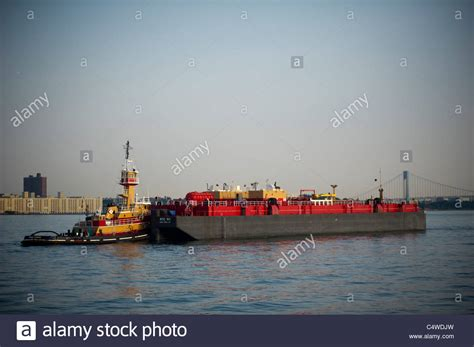 tugboat nj a tugboat pushes a fuel oil barge in the new york and new