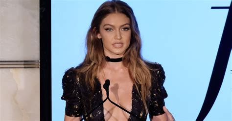 adultwork mobile gigi hadid risks nip slip in plunging black and gold gown