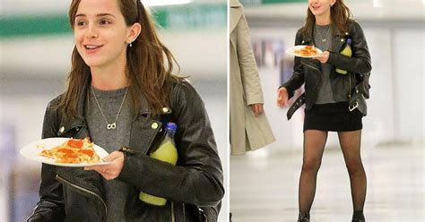 emma watson eating emma watson eats pizza at jfk airport after holiday with