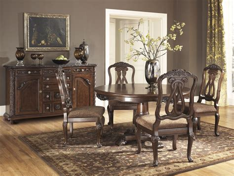 north shore dining room north shore round pedestal dining room set from ashley