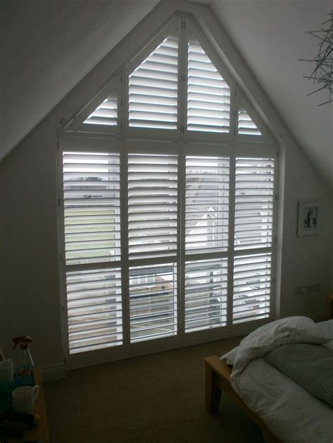 Dormer Window Coverings A Gable End Window With Wood Shutters