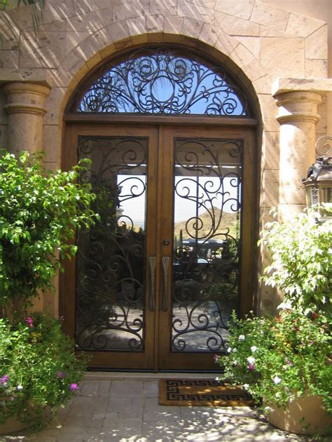 Tuscan Front Doors Tuscan Home Exterior In Palm Desert Arched Window Wrought Iron Front Door By Artistic Doors