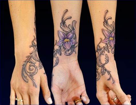 tattoo on hand flowers purple flower tattoo on hand