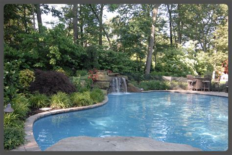 Pool Landscapes | modern pool landscaping ideas with rocks and plants