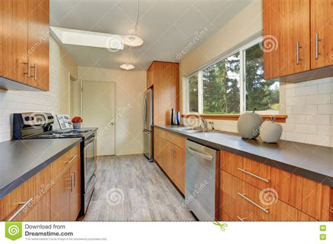 kitchen towards the back and extra bedroom space to the narrow kitchen room with long grey counters stock image