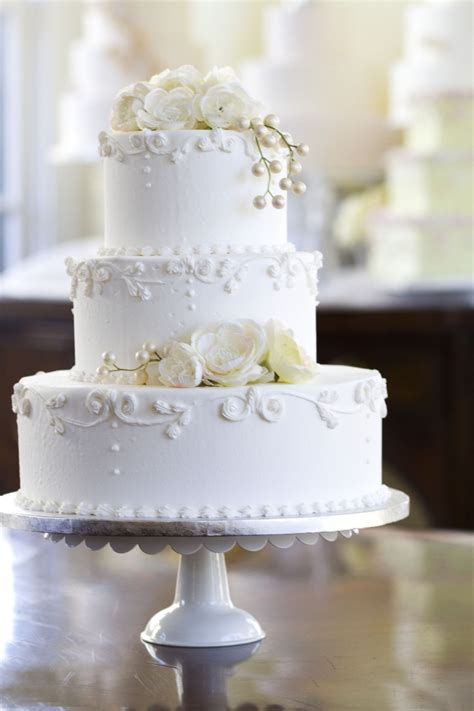 classic purple and white wedding cake with marzipan roses a classic white floral design wedding cake i would