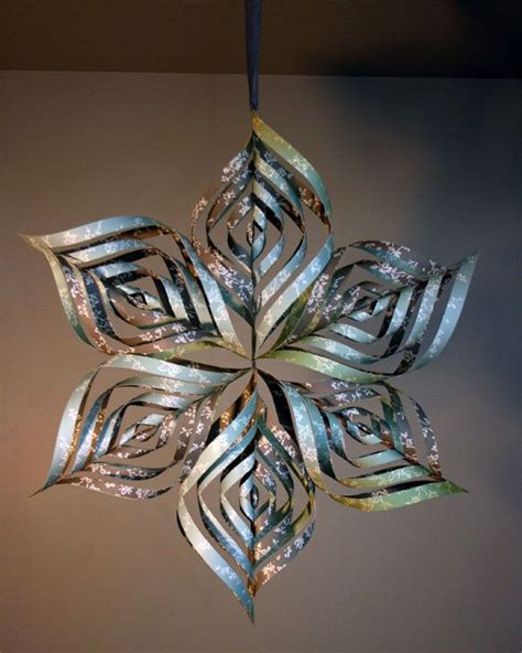 How To Make Paper Snowflake Ornaments - paper snowflake can also make smaller ornaments using