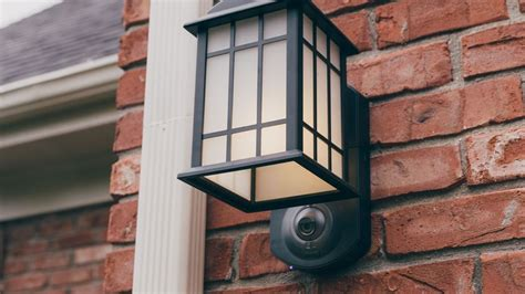 front door light with camera kuna light fixture review this snazzy porch light doubles