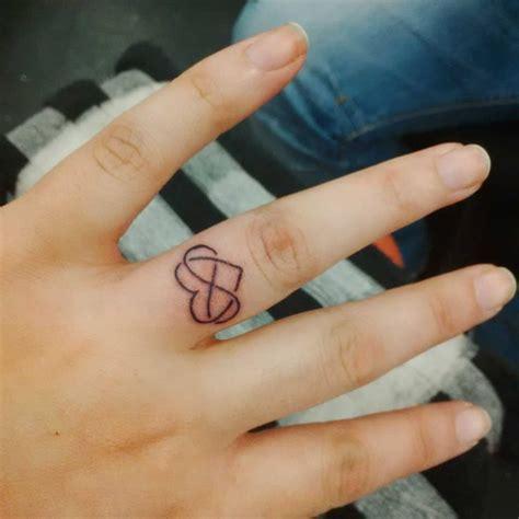 heart tattoo on wedding finger heart tattoo ring danielhuscroft com