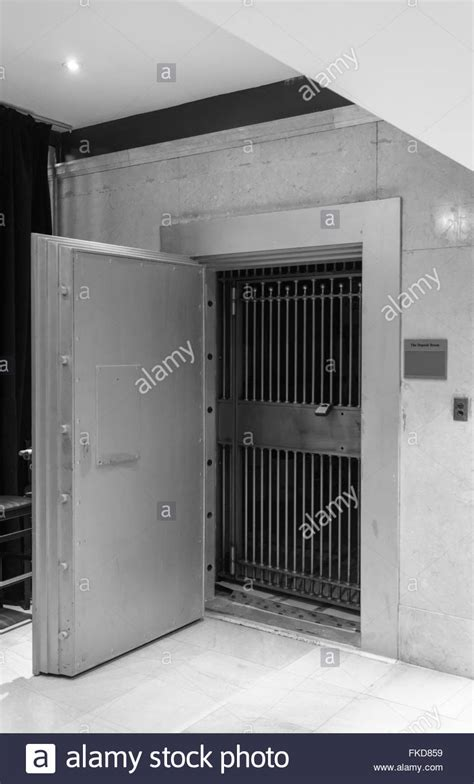 bank vault with open door closed grill with lock stock photo royalty free image 98022101 alamy