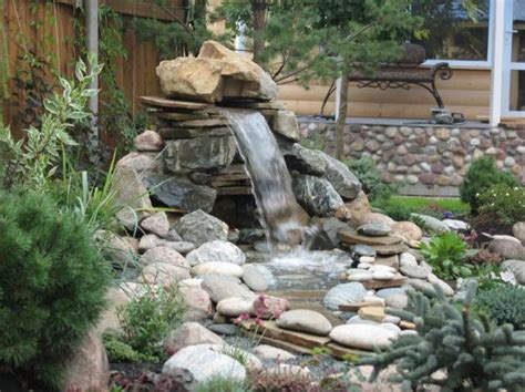 21 waterfall ideas to add tranquility to rock garden design