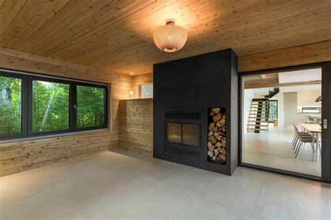 scandinavian cabin surrounded  nature nonagonstyle