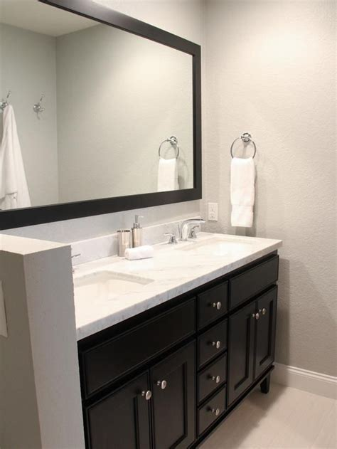 contemporary bathroom  black vanity  mirror