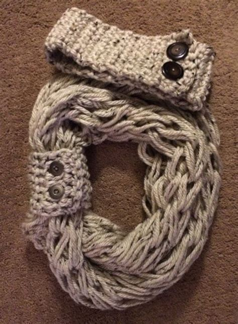 how does it take to knit a scarf arm knit infinity scarf with matching button cuff and