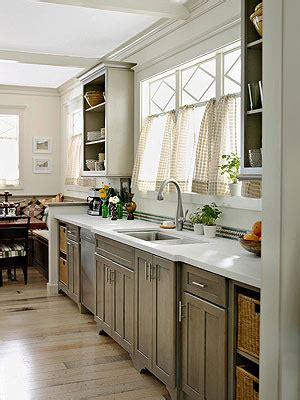 grey stained cabinets like the lighter grey 2nd but the flat drawer profile of the 3rd gray kitchen cabinets
