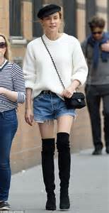 diana boots diane kruger flashes some skin in cut shorts and