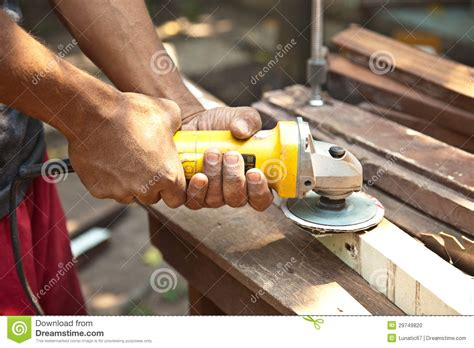 Hand Holding Wood Grinder. Stock Photo   Image: 29749820