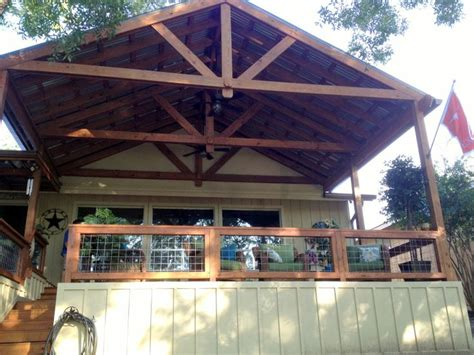Open truss porch cover that gives shade and weather