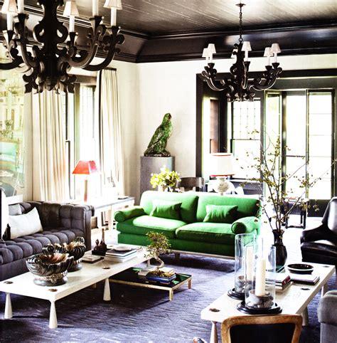 black ceiling black ornate pendents green sofa living room
