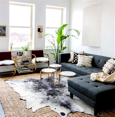 How To Lay A Rug In Living Room by 5 Reasons To Layer Living Room Rugs Decorilla
