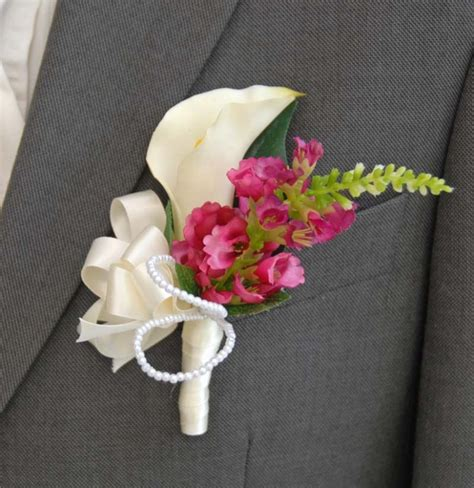 Fiscus wedding flowers for a groom with a calla lily amp pearl
