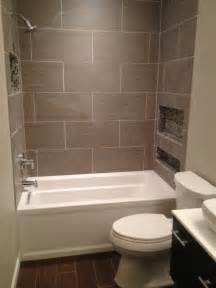 Tiles For Small Bathrooms Larger Rectangular Tiles Around A White Alcove Tub Ours