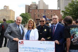 jamie nummer the hfh foundation presents grant to public safety foundation